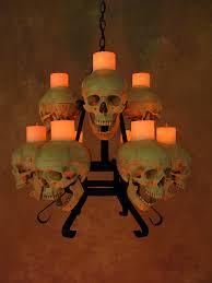 two tiered skull metal chandelier w nine skulls wax candles