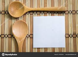 blank note paper with wooden spoon on wooden background cooking concept stock image