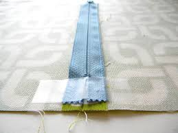 To put in the zipper, switch to a zipper foot on your machine and sew, with  a regular stitch length, along both sides of the zipper's twill tape.
