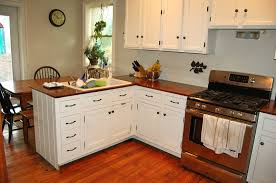 shaped brown painted wooden kitchen cabinets modern color wood paint schemes gray pallet wall granite top