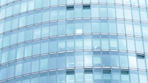 office building facade. Real Time Tilt Down Shot Of A Glass Office Building Facade With Reflecting Clouds And Modern City Architecture. Stock Video Footage - Videoblocks