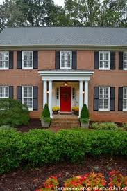 Small Picture brick house with navy shutters Google Search Curb Appeal