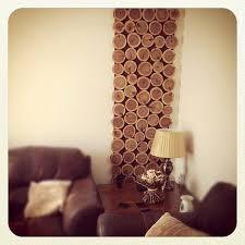 diy cedar wood slices wall art via charlottehupfieldceramics