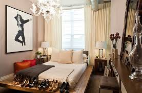 bedrooms small bedroom with cozy bed and rustic bed frame under crystal clear chandelier small