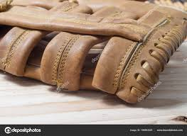 old worn leather baseball glove stock photo