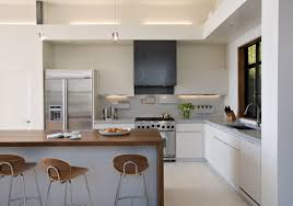 nice lighting. Stunning White Kitchen Design With Pendant Lamps And Wooden Surface Bar Table Stools Nice Lighting