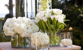 White wedding centerpieces Yellow Ranunculus Tulips And Orchids Add Interesting Textures To An All White Wedding Centerpiece Hi Miss Puff White Wedding Centerpieces Hi Miss Puff