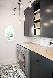 black laundry room cabinets with maple butcher block countertops