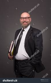 portrait bellied hipster bearded businessman on stock photo portrait of bellied hipster bearded businessman on dark grey bold man in business suit happy