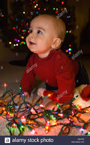 Baby Pics With Christmas Lights Seven Month Old Baby Boy With Christmas Lights Stock Photo