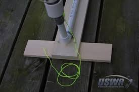 how to build a cable tie water rocket launcher connect a short piece of string to one side of the release collar as shown