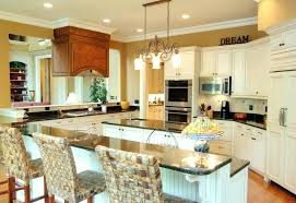 white kitchen cabinets with black countertops this warm cozy kitchen is achieved with the use of golden walls and off antique white kitchen cabinets with