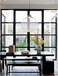 firm believer at home in breda with the cofounder of moooi article from elle decor magazine beautiful dining e with floor to ceiling windows gives