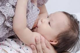 asian mom t feeding her baby