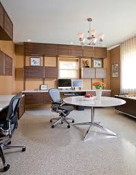 pink home office design idea. Custom Floating Desks Inspired By Midcentury Classics Provide Ample Workspace For Two In This Basement Home Pink Office Design Idea
