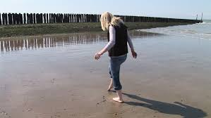 hd1080i scandinavian blond woman painting a heart on the sand with barefoot