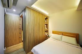 a hinged door hides away the l shaped walk in wardrobe