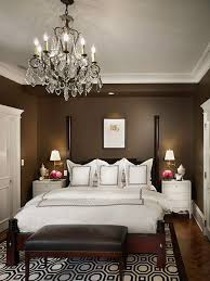 Inspiration for a timeless dark wood floor bedroom remodel in Chicago with brown  walls