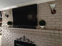 how to hide wires behind tv above brick fireplace image