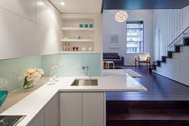 Small minimalist l-shaped dark wood floor open concept kitchen photo in New  York with