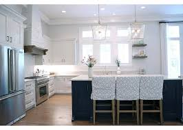 view full size a blue kitchen island with open shelves