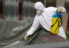asbestos removal companies spraying ceiling tiles