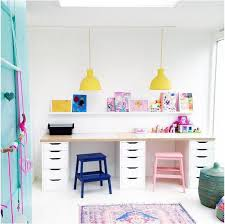 I love everything about your shared kids playroom/desk space! The painted  stools are awesome, the happy yellow lights are fun, the baskets are cool  ...
