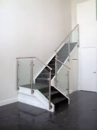 contemporary glass railing design featuring brushed stainless steel elements glass panels were ancd to stainless steel glass clamps on each post