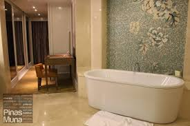 the bathroom is generously spacious where two guests can comfortably move around the floor and the walls are lined with marbles of luxurious quality
