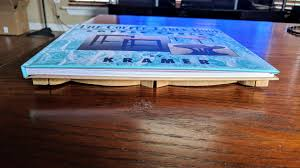 and the beauty of my book is if you don t have a coffee table it turns into a coffee table