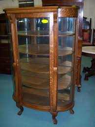 oak curved glass china or curio cabinet to expand