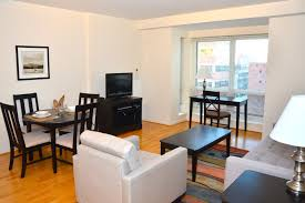 charming furnished studio apartment design with living and dining sets featuring white couch and wooden