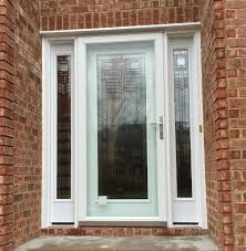 smooth fiberglass front entrance door and sidelights with decorative full light glass