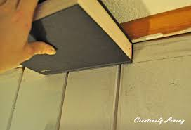 faux molding and painting for wood paneling under 30 cents ft with the kid s wednesday creatively living blog
