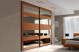 Mirrored sliding doors, contemporary closet designs perfect for small spaces