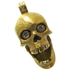 a wicked gold and diamond skull pendant the 1 1 2 with bale by 3 4 18k yellow gold skull with hinged jawbone full cut diamond eyes and diamond