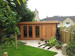 Small Picture This versatile log cabin incorporates a garden room with an