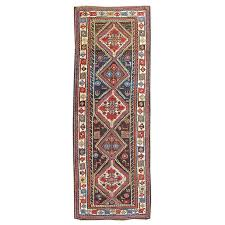 late 19th century transcaucasian runner rug with brown and blue field for