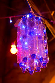 file plastic bottles and led lights repurposed as a chandelier during ramadan in muslim quarter