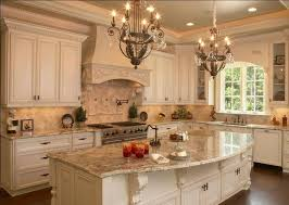 some elements of a french country kitchen glazed painted cabinets arched window corbels under the island and range hood