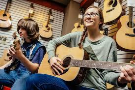 Classical vs. <b>Acoustic Guitar</b>: What's the Difference?