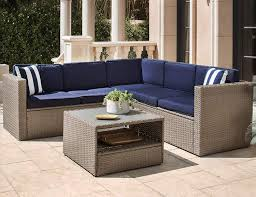 Solaura outdoor 4 piece furniture sectional sofa set all weather warm grey wicker with nautical navy blue cushions sophisticated glass coffee table