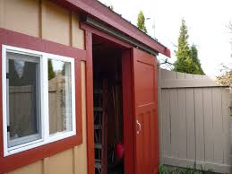 red sliding barn door. Furniture. Rectangle Red Wooden Sliding Barn Door Having Steel Handle Plus Black Track On Top