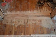 repairing hardwood floor in new doorway 7