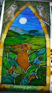owl and hare stained glass