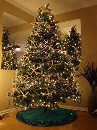Beach Christmas Tree - Starfish Garland with white fishing net!) and  rethink the topper and the tree skirt.