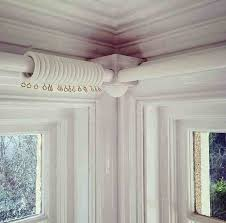corner bracket for curtain poles in bay window