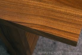 custom made solid hardwood table top for restaurant in sapele on tzoid legs