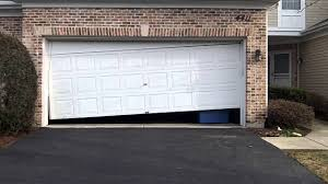 garage door off trackA Crooked Garage Door in LisleIL  6302719343  YouTube