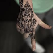 Ganesha Head Tattoo On Hand By Niki Norberg